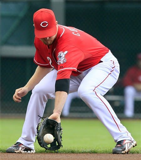 Cincinnati Reds shortstop Zack Cozart fields a ground ball hit by Milwaukee Brewers' Aramis Ramirez in the fourth inning of a baseball game, Thursday, Sept. 27, 2012, in Cincinnati. Cozart threw Ramirez out at first. (AP Photo/Al Behrman)