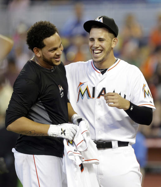 Miami Marlins starting pitcher Henderson Alvarez, left, and Jose Fernandez, right, celebrate Alvarez's no-hitter against the Detroit Tigers after an interleague baseball game on Sunday, Sept. 29, 2013, in Miami. The Marlins won 1-0. (AP Photo/Alan Diaz)