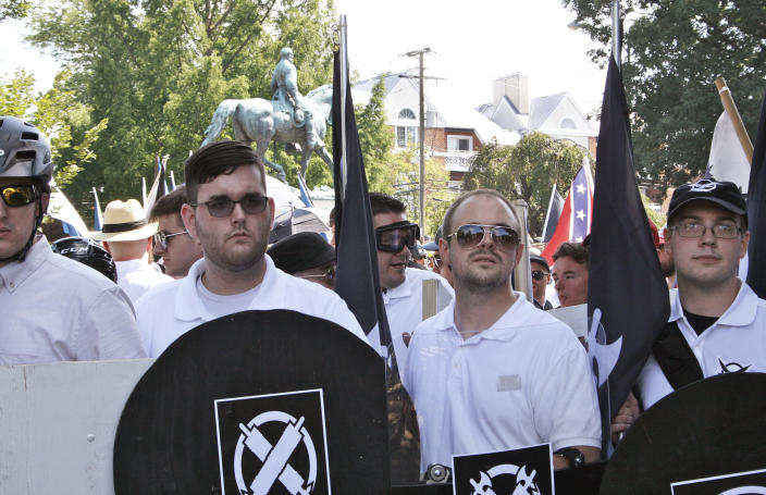 <p>In this Saturday, Aug. 12, 2017 photo, James Alex Fields Jr., second from left, holds a black shield in Charlottesville, Va., where a white supremacist rally took place. Fields was later charged with second-degree murder and other counts after authorities say he plowed a car into a crowd of people protesting the white nationalist rally. (Photo: Alan Goffinski via AP) </p>