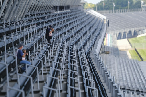 Empty seats watch thrilling Indy 500, spectacular wrecks