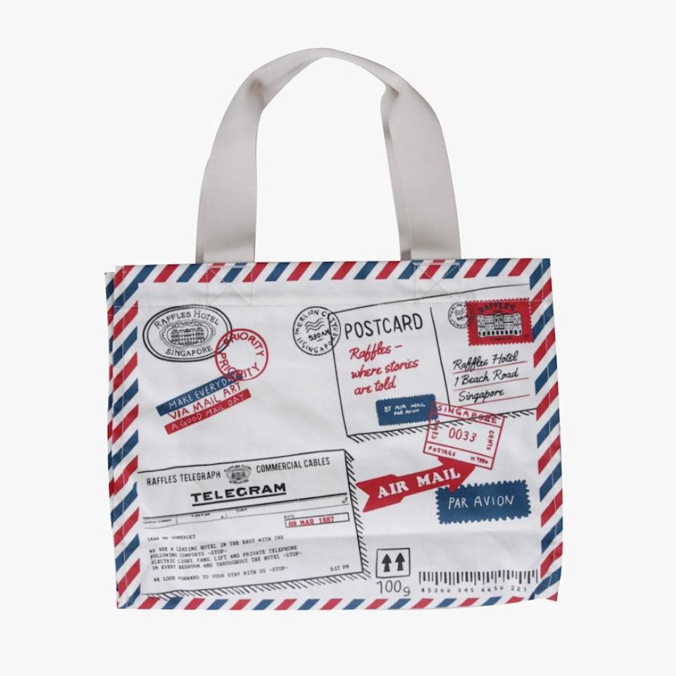 """The Raffles Hotel Singapore is something you'll certainly want to write home about. Or you can buy this tote that features all the letters you didn't write. $82, RAFFLES ARCADE. <a href=""""https://www.rafflesarcade.com.sg/product/fashion-and-accessories-/tote-bag-with-raffles-mail-design"""" rel=""""nofollow noopener"""" target=""""_blank"""" data-ylk=""""slk:Get it now!"""" class=""""link rapid-noclick-resp"""">Get it now!</a>"""