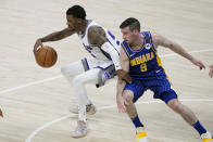 Sacramento Kings' Delon Wright (55) is defended by Indiana Pacers' T.J. McConnell (9) during the first half of an NBA basketball game Wednesday, May 5, 2021, in Indianapolis. (AP Photo/Darron Cummings)