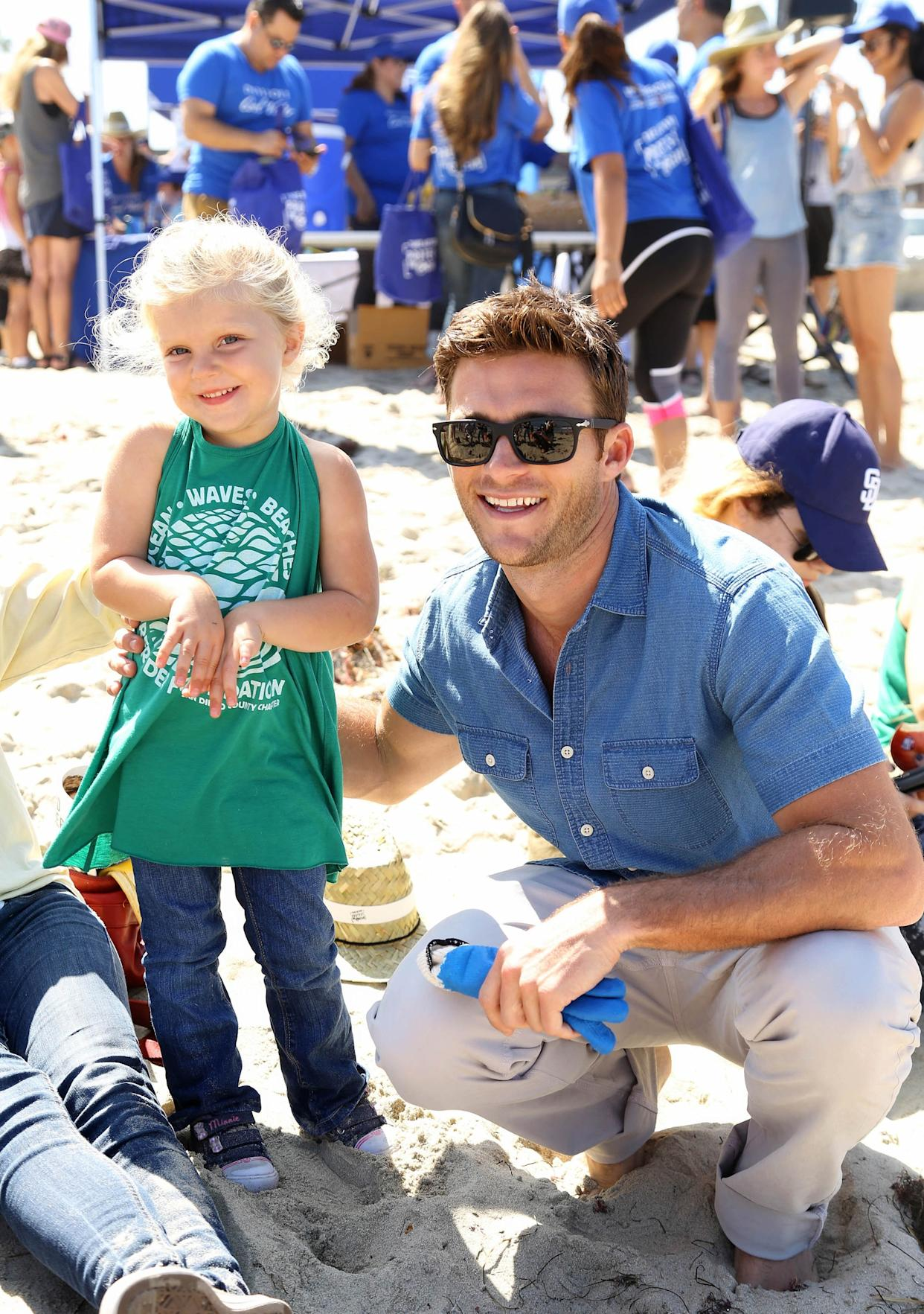 New York City -  July 10, 2016:  Looking good while doing good, Scott Eastwood, the face of Davidoff Cool Water, supports the brand's #LoveTheOcean campaign at a beach cleaunp in Ocean Beach. -  PICTURED: Scott Eastwood with fan- PHOTO BY: Sara Jaye Weiss/StartraksPhoto.com