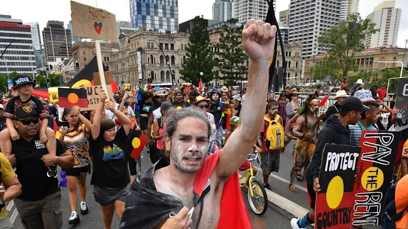 Protesters in Brisbane have called for an end to the celebration of Australia Day on January 26