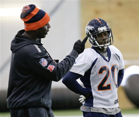 Denver Broncos assistant secondary coach Sam Garnes works with free safety Mike Adams during their practice session for the Super Bowl at the New York Jets Training Center in Florham Park, New Jersey January 30, 2014. REUTERS/Ray Stubblebine