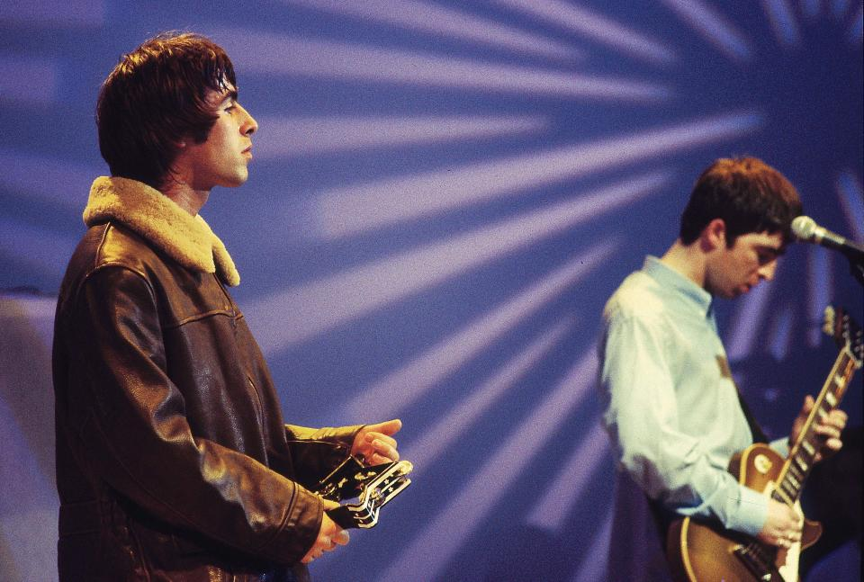 UNITED KINGDOM - APRIL 14:  Photo of OASIS; Liam Gallagher and Noel Gallagher performing on UK TV show  (Photo by Des Willie/Redferns)