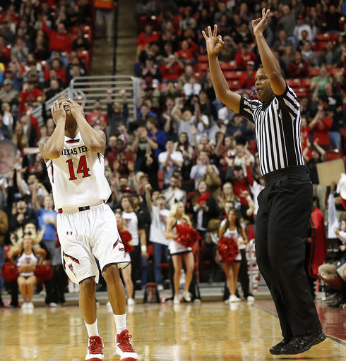 Texas Tech's Robert Turner (14) celebrates hitting a 3-point basket against Baylor during an NCAA college basketball game in Lubbock, Texas, Wednesday, Jan, 15, 2014. (AP Photo/Lubbock Avalanche-Journal, Tori Eichberger)