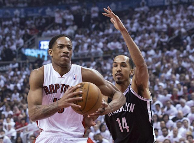 Toronto Raptors' DeMar DeRozan, left, drives on Brooklyn Nets' Shaun Livingston during the first half of Game 1 of an opening-round NBA basketball playoff series, in Toronto on Saturday, April 19, 2014. (AP Photo/The Canadian Press, Chris Young)