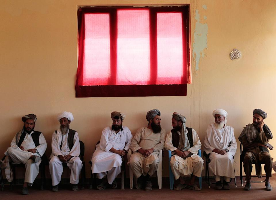 <p>Village elders sit before the start of a shura meeting with local Afghan government officials and officers from the US Army's 82nd Airborne Division June 29, 2010 in Bala Murghab, Afghanistan. The 82nd Airborne along with NATO Italian troops have been working for nearly a year in this combative zone in the far northwest of the country near the Turkmenistan border, attempting to pacify and extend the Afghanistan central government rule to this rural and fiercely independent area rife with Taliban insurgents. (Photo by Chris Hondros/Getty Images) </p>