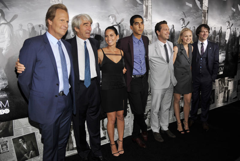 """Left to right, """"The Newsroom"""" cast members Jeff Daniels, Sam Waterston, Olivia Munn, Dev Patel, Thomas Sadoski, Alison Pill and John Gallagher Jr. pose together at the season 2 premiere of the HBO series at the Paramount Theater on Wednesday, July 10, 2013 in Los Angeles. (Photo by Chris Pizzello/Invision/AP)"""