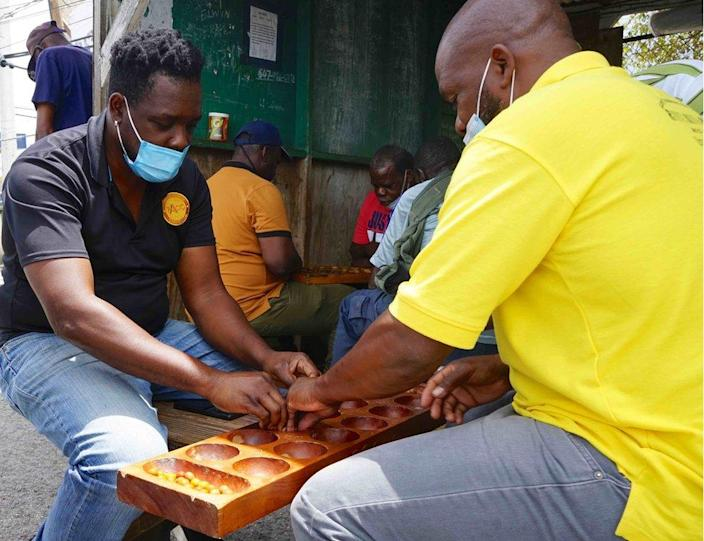 A Warri game being played in the bus station in St John's