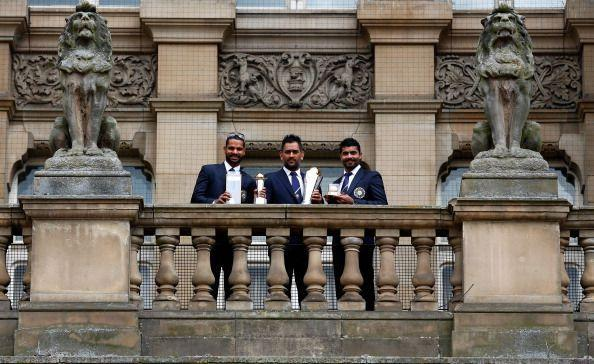 Dhoni with Shikar Dhawan (left) and Ravindra Jadeja (right), India's two biggest match-winners in the Champions Trophy 2013