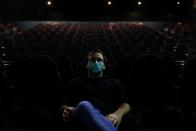 Diogo watches a movie on the first day of the opening of cinema theatres, in Sintra