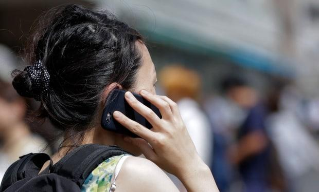 Thousands of Rogers customers across the country lost their cellular services for much of the day on Monday. (Kiyoshi Ota/Bloomberg - image credit)