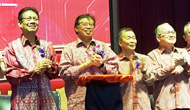 Chief Minister Datuk Patinggi Abang Johari Openg (second left) at the joint opening of six PBB branches annual general meetings, January 21, 2018. — Picture by Sulok Tawie