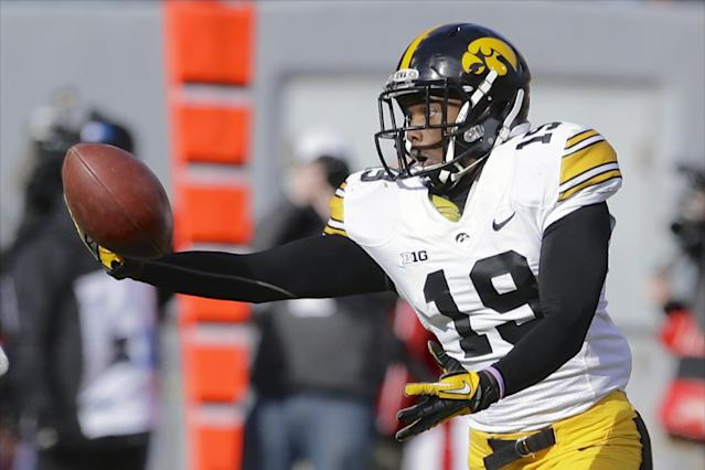 Iowa defensive back B.J. Lowery (19) nearly gets an interception on a throw by Nebraska quarterback Ron Kellogg III, in the first half of an NCAA college football game in Lincoln, Neb., Friday, Nov. 29, 2013. (AP Photo/Nati Harnik)