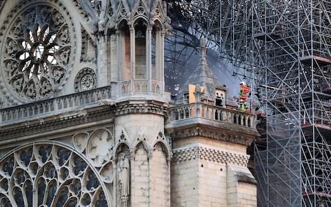 National mourning over the damage done to Notre-Dame Cathedral has continued into the second day - Credit: Gareth Fuller/PA