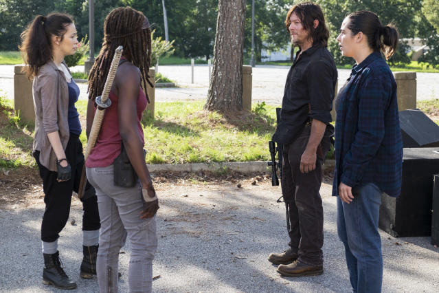 Norman Reedus as Daryl Dixon, Alanna Masterson as Tara Chambler, Christian Serratos as Rosita Espinosa, and Danai Gurira as Michonne in <em>The Walking Dead</em> (Photo Credit: Gene Page/AMC)