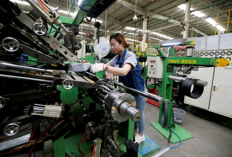FILE PHOTO: FILE PHOTO: An employee works on the production line of a tyre factory under Tianjin Wanda Tyre Group in Xingtai