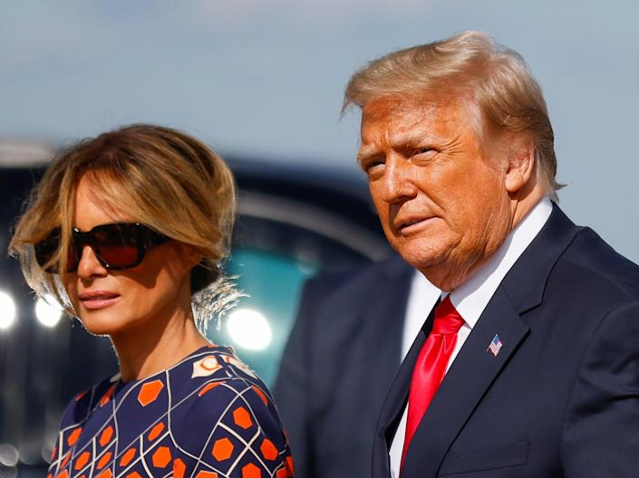 <p>Former president Donald Trump and first lady Melania Trump arrive at Palm Beach International Airport in West Palm Beach on 20 January, 2021</p> (REUTERS)