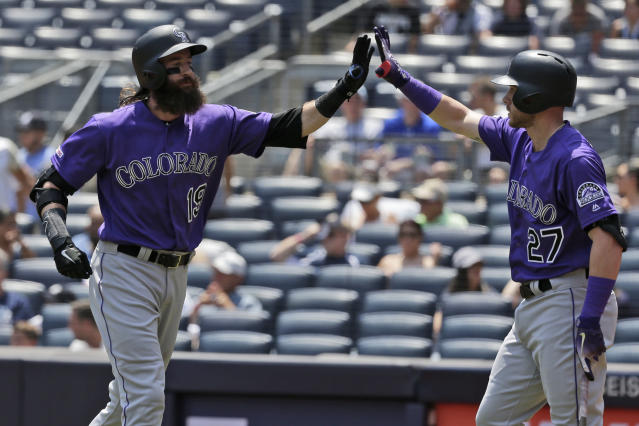 Colorado Rockies' Charlie Blackmon, left, celebrates with Trevor Story after hitting a solo home run during the first inning of a baseball game against the New York Yankees at Yankee Stadium, Sunday, July 21, 2019, in New York. (AP Photo/Seth Wenig)