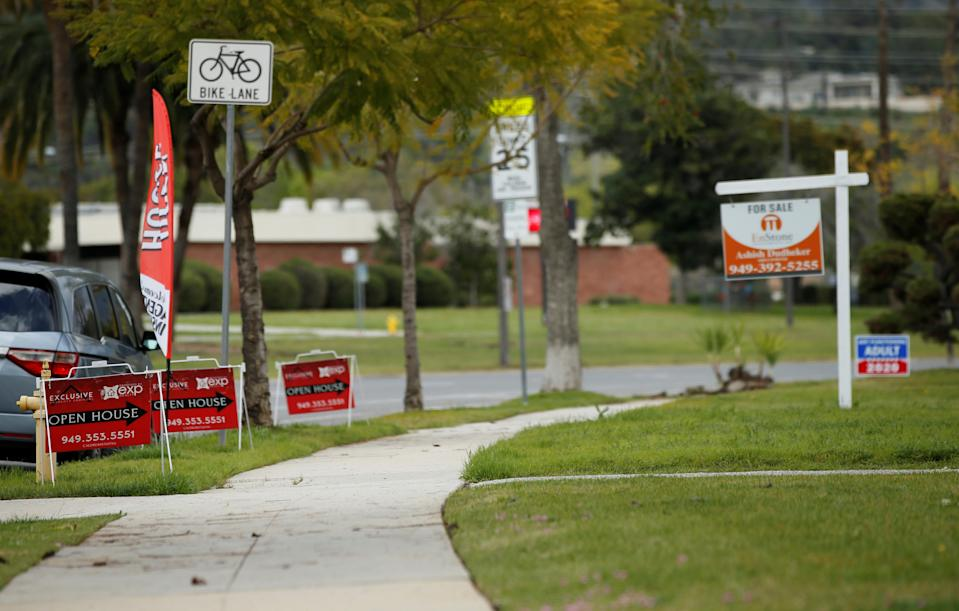 Signs advertising an open house are pictured during the global outbreak of coronavirus (COVID-19), in Pasadena, California, U.S. March 15, 2020. REUTERS/Mario Anzuoni