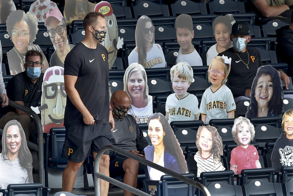 Injured Pittsburgh Pirates pitcher Jameson Taillon walks through the section with cutout images of fans in the stands at PNC Park before a baseball game against the Minnesota Twins, Thursday, Aug. 6, 2020, in Pittsburgh. (AP Photo/Keith Srakocic)