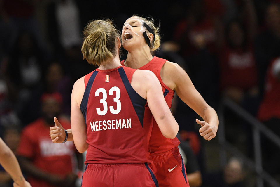 Washington Mystics center Emma Meesseman (33) and Elena Delle Donne, back reacts during the second half of Game 2 of a WNBA playoff basketball series against the Las Vegas Aces, Thursday, Sept. 19, 2019, in Washington. The Mystics won 103-91. (AP Photo/Nick Wass)