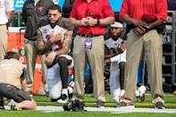 Sep 24, 2017; Minneapolis, MN, USA; Tampa Bay Buccaneers wide receiver Mike Evans (13) and wide receiver DeSean Jackson (11) kneel for the national anthem prior to the game against the Minnesota Vikings at U.S. Bank Stadium. Mandatory Credit: Brace Hemmelgarn-USA TODAY Sports