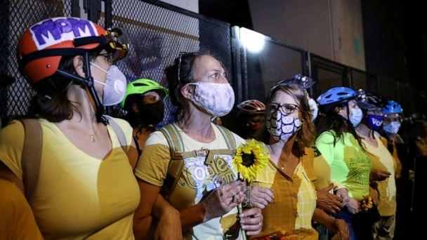 PHOTO: Mothers stand between federal law enforcement officials and demonstrators during a protest against racial inequality in Portland, Oregon, July 19, 2020. (Caitlin Ochs/Reuters)