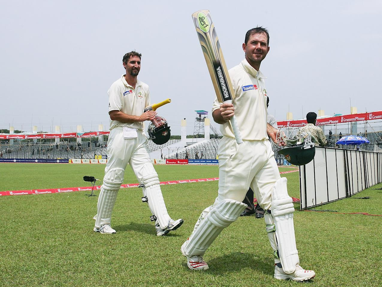 DHAKA, BANGLADESH - APRIL 13:  Ricky Ponting (R) and Jason Gillespie of Australia celebrate victory as they leave field during day five of the First Test between Bangladesh and Australia played at the Fatullah Ground on April 13, 2006 in Dhaka, Bangladesh.  (Photo by Hamish Blair/Getty Images)