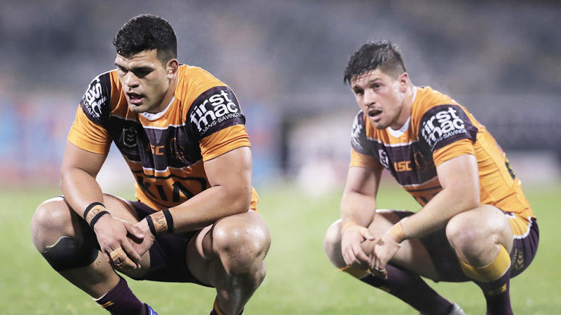 David Fifita (pictured left) and Cory Paix (pictured right) tire during a match for the Broncos.