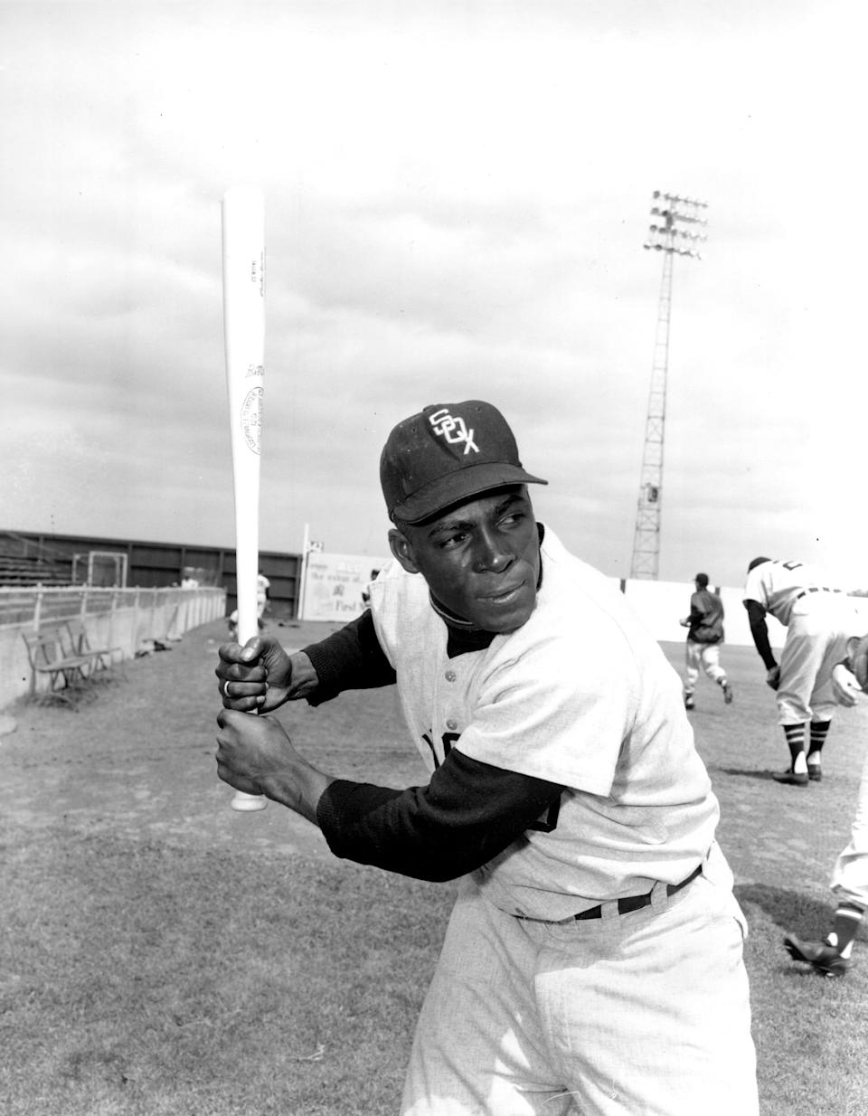 """In this 1957 file photo, Chicago White Sox outfielder Orestes """"Minnie"""" Minoso poses at Al Lopez Field in Tampa, Fla."""