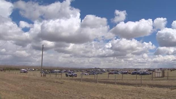The rodeo was held on private land because the town's agricultural society revoked its permit following discussions with Alberta Health Services.