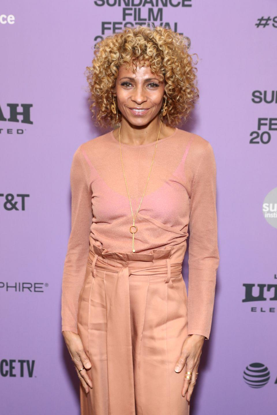 <p>Peach hair doesn't need to be vibrant — you can incorporate the shade in the most subtle ways. <strong>Michelle Hurd's</strong> curls have just the slightest whisper of peach. </p>