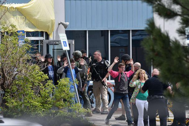 PHOTO: Students and teachers raise their arms as they exit the scene of a shooting in which at least seven students were injured at the STEM School Highlands Ranch on May 7, 2019, in Highlands Ranch, Colorado. (Tom Cooper/Getty Images, FILE)