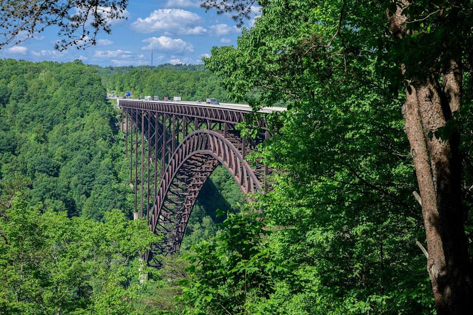 """<p><strong>New River Gorge Bridge</strong></p><p>The <a href=""""https://www.nps.gov/neri/planyourvisit/nrgbridge.htm"""" rel=""""nofollow noopener"""" target=""""_blank"""" data-ylk=""""slk:New River Gorge Bridge"""" class=""""link rapid-noclick-resp"""">New River Gorge Bridge</a> is a steel arch bridge that spans 3,030 feet long over the New River Gorge near Fayetteville, West Virginia. For 26 years, it was the world's longest single-span arch at 1,700 feet long, but now sits at the number four spot. Located in the Appalachian Mountains it defines taking the scenic route.</p>"""