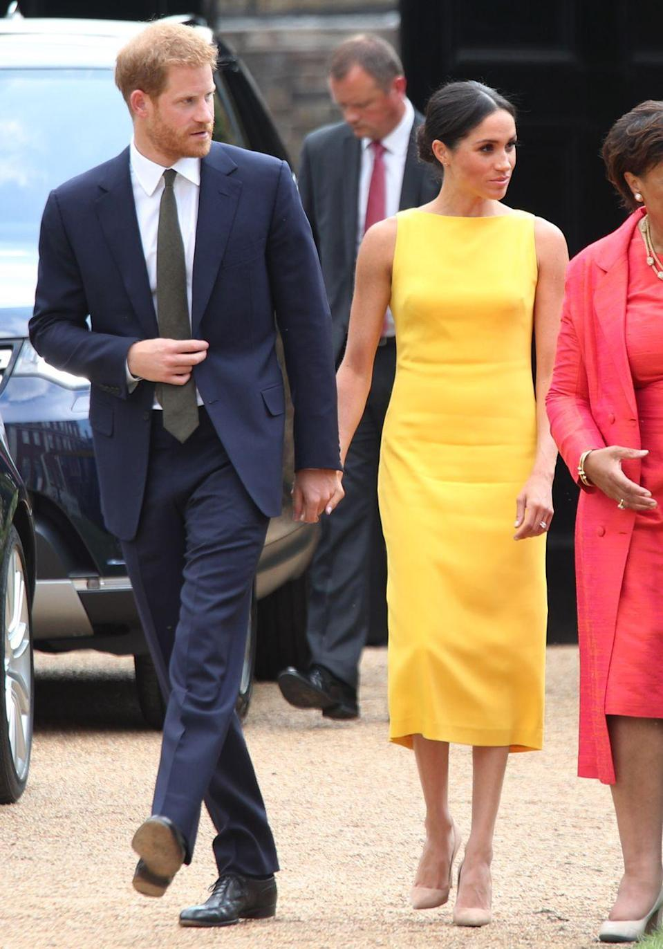 "<p>The royals showed subtle PDA while attending <a href=""https://www.townandcountrymag.com/style/fashion-trends/a22062433/meghan-markle-brandon-maxwell-dress-commonwealth-youth-challenge-reception/"" rel=""nofollow noopener"" target=""_blank"" data-ylk=""slk:the Your Commonwealth Youth Challenge reception"" class=""link rapid-noclick-resp"">the Your Commonwealth Youth Challenge reception</a> in London on July 5. </p>"