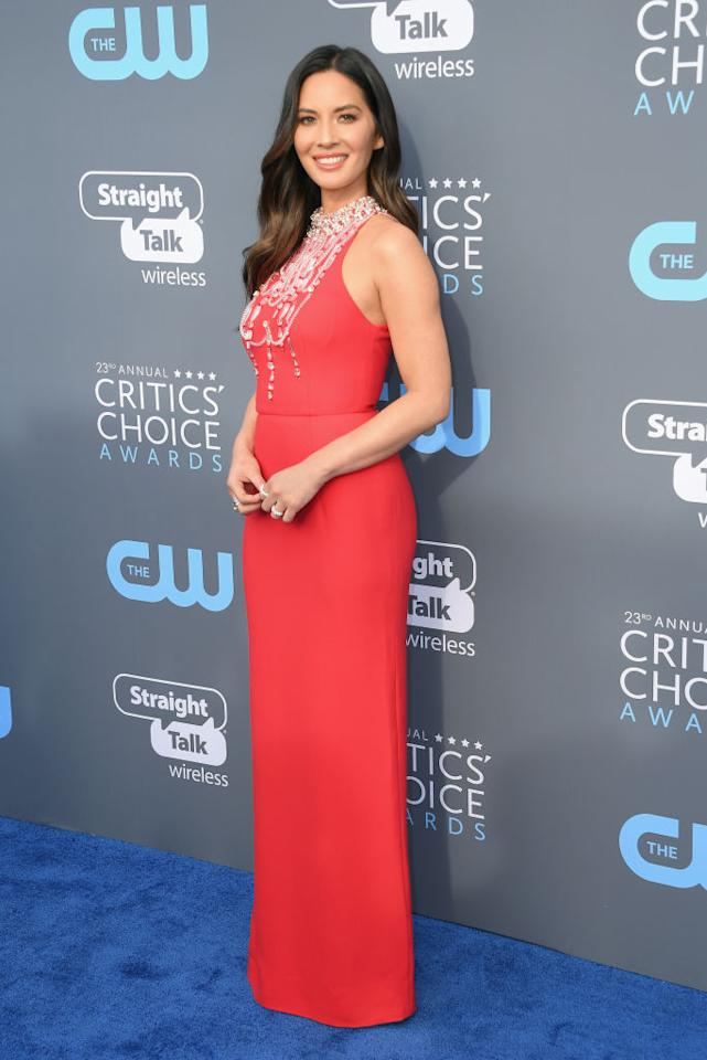 <p>The show's host went for a fiery and sophisticated look for her first outfit of the night. (Photo: Getty Images) </p>