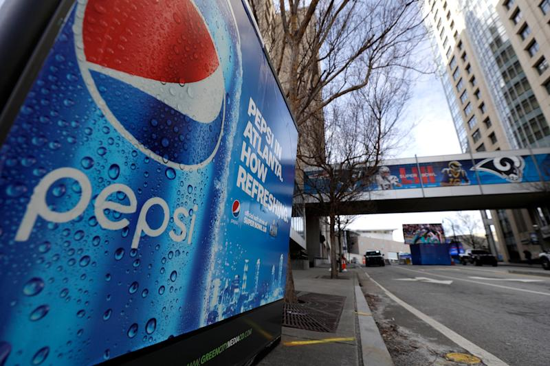 FILE- This Jan. 30, 2019, file photo an advertisement for Pepsi is shown downtown for the NFL Super Bowl 53 football game in Atlanta. PepsiCo Inc. reports earns on Friday, Feb. 15, 2019. (AP Photo/David J. Phillip, File)
