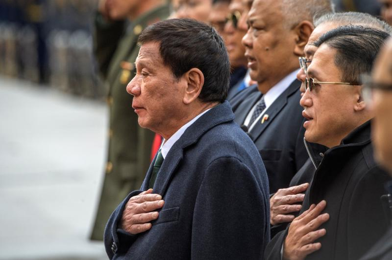 File Photo: Philippine President Rodrigo Duterte, center, attends a wreath laying ceremony at the Tomb of the Unknown Soldier in Moscow, Russia, Friday, Oct. 4, 2019. (Yury Kadobnov/Pool Photo via AP)