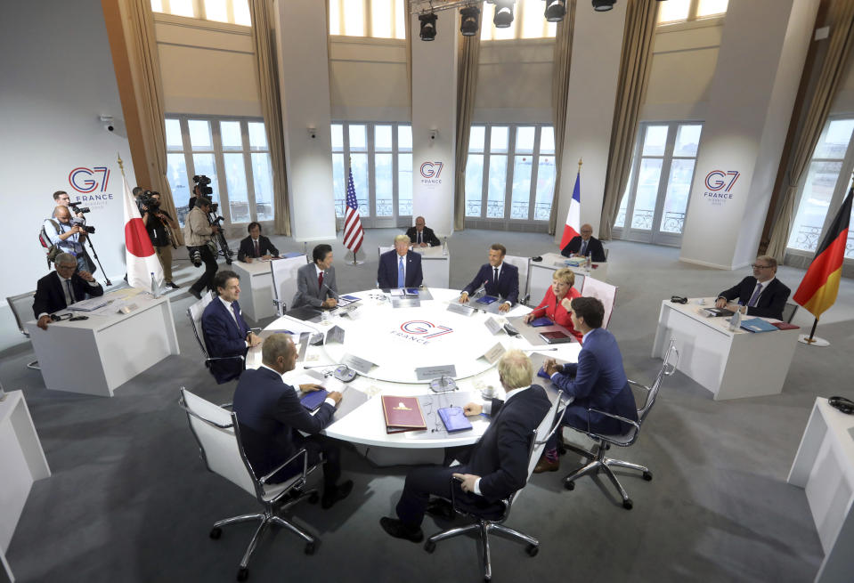 FILE - In this Aug. 25, 2019, file photo world leaders prepare to start a working session on World Economy and Trade on the second day of the G-7 summit in Biarritz, France. They are from clockwork top center: President Donald Trump, French President Emmanuel Macron, German Chancellor Angela Merkel, Canadian Prime Minister Justin Trudeau, Britain's Prime Minister Boris Johnson, President of the European Council Donald Tusk, Italian Premier Giuseppe Conte and Japanese Prime Minister Shinzo Abe. Already on a first-name basis with relationships that range from just months to years, the leaders of the Group of 7 industrialized democracies are gathering Friday amid hopes that the departure of their most unruly member and a new era of personal friendships enhanced by face-to-face discussions can restore a global anti-authoritarian consensus on climate, coronavirus, China and Russia. (AP Photo/Markus Schreiber, File)