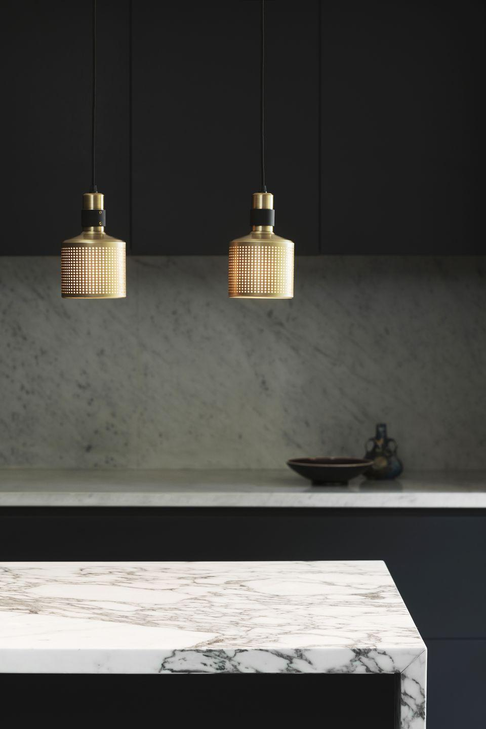 """<p>Changing the lighting brings a fresh perspective to a tired kitchen, and these brushed-brass pendants instantly add a modern touch. It's also worth noting that simply replacing the bulbs can have a huge impact too. If you've currently got harsh white light, a softer orange glow will give the space a completely different ambience – and be more forgiving on areas of wear and tear.</p><p>Pictured: Riddle pendant lights in brushed brass, <a href=""""https://bertfrank.co.uk/"""" rel=""""nofollow noopener"""" target=""""_blank"""" data-ylk=""""slk:Bert Frank"""" class=""""link rapid-noclick-resp"""">Bert Frank</a></p>"""