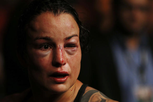 In this early Sunday, May 13, 2018 photo, U.S. competitor Raquel Pennington leaves the octagon after losing the UFC women's bantamweight mixed martial arts bout against Amanda Nunes, from Brazil, in Rio de Janeiro, Brazil. (AP Photo/Leo Correa)