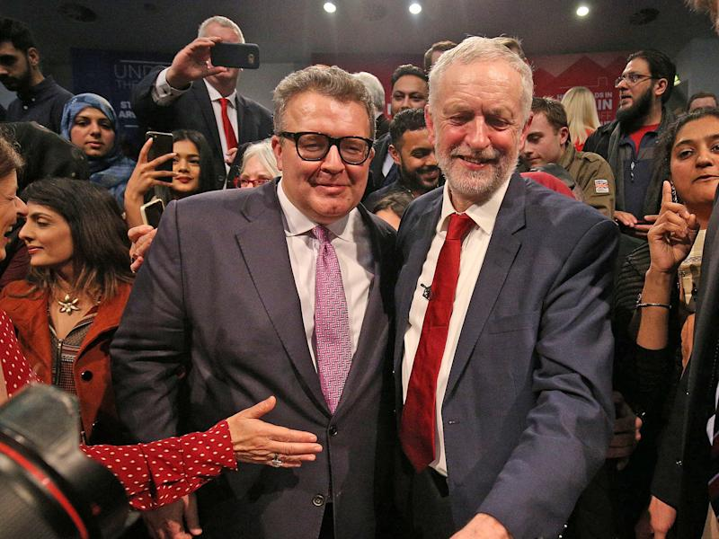 Labour party leader Jeremy Corbyn is congratulated by deputy leader Tom Watson after he addresses a post-Budget rally at the Bethel Convention Centre, West Bromwich, in 2017: Aaron Chown/PA Archive/PA Images