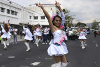 """Members of the """"Pearls of the East"""" parade squad perform marking the International Day Against Homophobia, in San Salvador, El Salvador, Monday, May 17, 2021. The parade squad, in which Zashy Zuley del Cid Velásquez participated, started with some 50 people, but crime and forced displacement have shrunk it to 35, said Venus Nolasco, director of the San Miguel LGBTQ collective """"Pearls of the East."""" (AP Photo/Salvador Melendez)"""