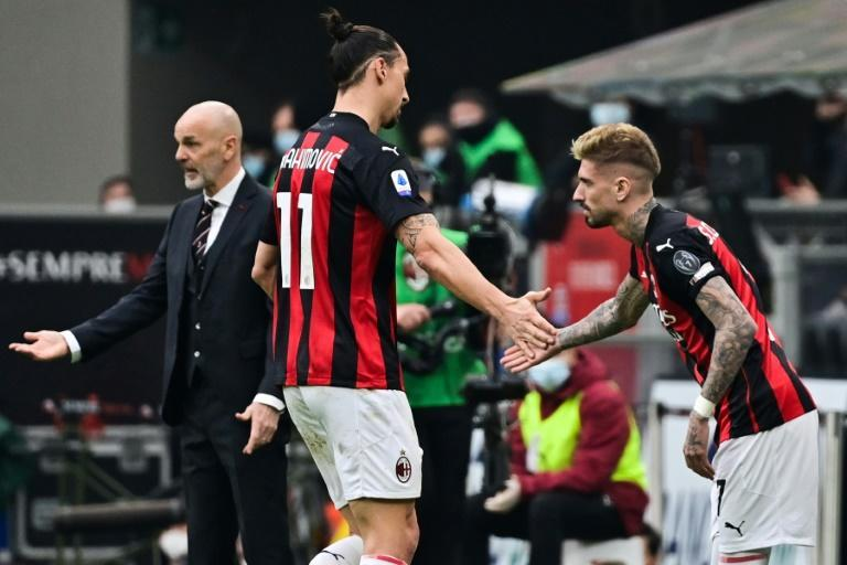 AC Milan forward Zlatan Ibrahimovic (C) went off with calf cramps in the San Siro.