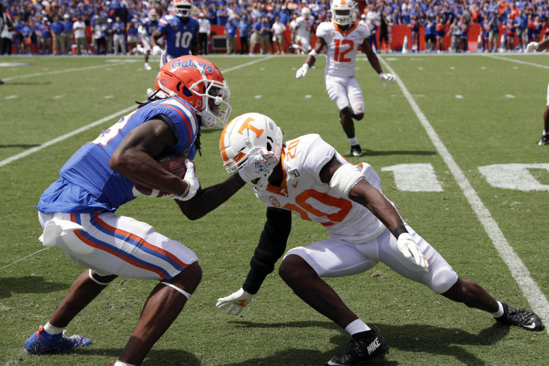 Florida wide receiver Tyrie Cleveland, left, trries to get around Tennessee defensive back Bryce Thompson (20) after a reception during the first half of an NCAA college football game, Saturday, Sept. 21, 2019, in Gainesville, Fla. (AP Photo/John Raoux)