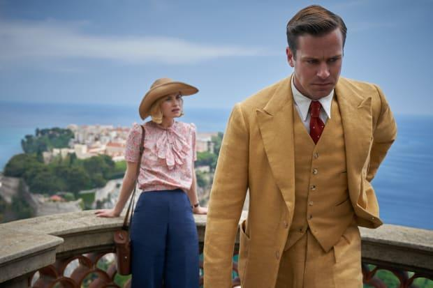 Old Hollywood inspiration in the background and Maxim (Armie Hammer) in his golden suit in the foreground.