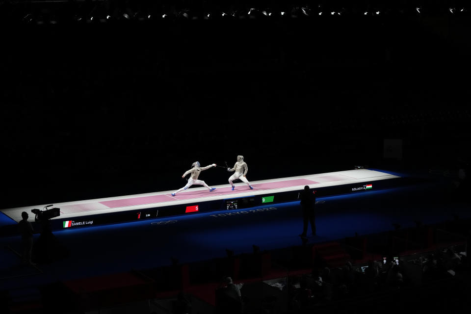 Aron Szilagyi of Hungary, right, and Luigi Samele of Italy compete in the men's individual final Sabre competition at the 2020 Summer Olympics, Saturday, July 24, 2021, in Chiba, Japan. (AP Photo/Hassan Ammar)